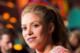 Shakira postpones tour over vocal cords, hopes for June return