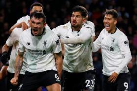 Ragnar Klavan leads the Liverpool celebrations after scoring the late winner against Burnley.