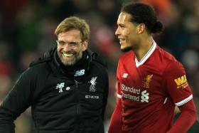 Liverpool boss Juergen Klopp (left) is delighted with Virgil van Dijk's dream debut.