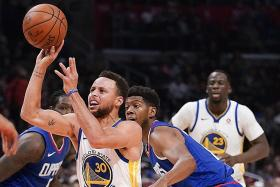 Golden State Warriors' Curry shreds Clippers apart