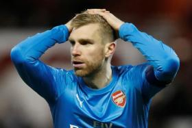 Arsenal defender Per Mertesacker accuses his teammates of lacking desire in defending the FA Cup.