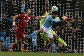 Sergio Aguero heading in Manchester City's winner in the 92nd minute.