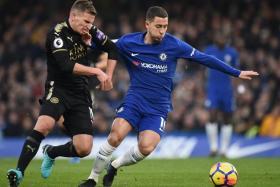 Chelsea's Eden Hazard fending off Leicester's Marc Albrighton in the 0-0 draw between both teams on Jan 13.