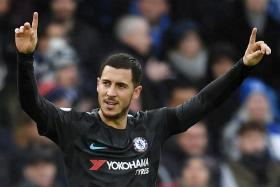 Chelsea's Eden Hazard celebrating after scoring against Brighton and Hove Albion on Saturday (Jan 20).