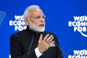 India's Modi defends open trade despite globalisation's waning allure