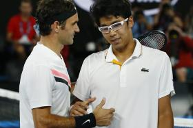 Roger Federer giving words of encouragement to South Korean sensation Chung Hyeon, who retired injured in the second set of their semi-final.