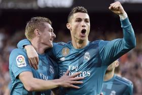 Cristiano Ronaldo (right) celebrating with Toni Kroos after scoring.