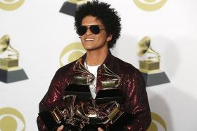 Bruno Mars triumphs at Grammys; Jay-Z is biggest loser
