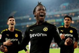 Michy Batshuayi (centre) celebrates after scoring against Cologne.