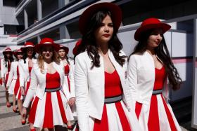 Grid girls walking in the paddock area during the Russian Grand Prix in Sochi last year.