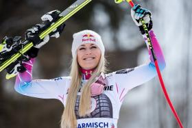 Lindsey Vonn won her race by two hundredths of a second over Italy's Sofia Goggia.
