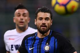 Inter Milan's Italian midfielder Antonio Candreva chasing the ball.