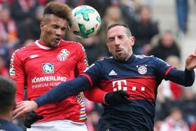 Bayern's Franck Ribery (right) challenging for the ball with Mainz's Jean Philippe Gbamin.