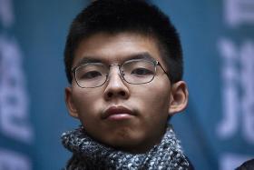 HK court frees democracy activist Joshua Wong, 2 others