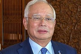 Malaysian PM Najib takes swipe at former leader