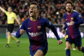 Philippe Coutinho celebrating after scoring against Valencia for his first goal in Barca colours.
