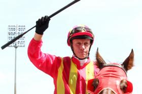 Jockey John Powell saluting the crowd after returning to the winner's enclosure on Paparazzi on Jan 21.
