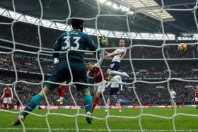Harry Kane heading in Tottenham's winner.