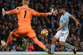 Sergio Aguero (right) chipping the ball over Leicester goalkeeper Kasper Schmeichel for his side's fourth goal and his third in their 5-1 win.