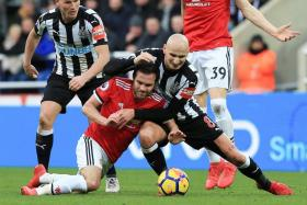 Newcastle's Jonjo Shelvey keeping Manchester United's Juan Mata on a tight leash.