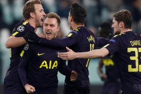 Christian Eriksen (second from left) celebrating with his teammates after scoring the equaliser through a free-kick.