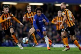 Chelsea's Willian (in blue) could have had a hat-trick, but saw an effort come back off the post two minutes from time.