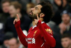 Liverpool's Mohamed Salah, a devout Muslim, is often seen kneeling in prayer after scoring.