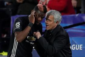 Manchester United manager Jose Mourinho giving instructions to Paul Pogba, who came on after Ander Herrera was injured in the 17th minute,