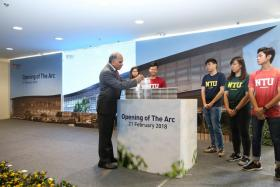 NTU president Subra Suresh launching The Arc with five NTU student leaders yesterday.