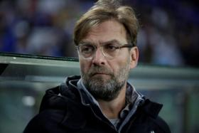 Liverpool manager Juergen Klopp says he wants to be happy at the end of the season and not during it.