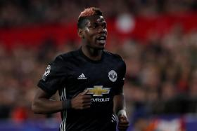 Chelsea's Antonio Conte will be reunited with Paul Pogba (above) during Sunday's clash with Manchester United. Pogba rose to prominence under him at Juventus.