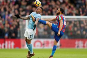 Manchester City striker Gabriel Jesus (left, being tackled by Crystal Palace's Andros Townsend) hurt his knee ligaments during their match against Palace on Dec 31.
