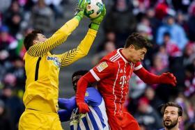 Robert Lewandowski going for a header during Bayern Munich's 0-0 draw with Hertha Berlin on Saturday.