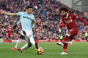Mohamed Salah (right) scoring Liverpool's second goal.