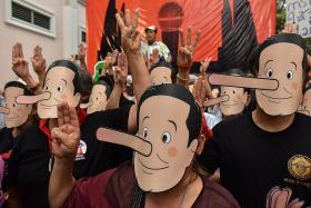 Thai activists in Pinocchio masks call junta leader 'liar'