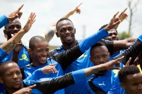 Retired sprint legend Usain Bolt posing with the Mamelodi Sundowns football team in Johannesburg, South Africa, in January.