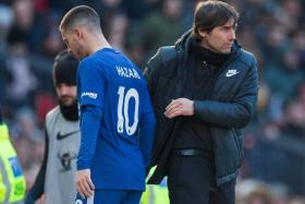 Antonio Conte (left, with Eden Hazard) is hoping to lift his charges after losing 2-1 to Manchester United in their last match.