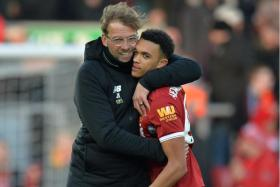 Liverpool manager Juergen Klopp giving right back Trent Alexander Arnold a hug after last month's 4-1 win over West Ham.
