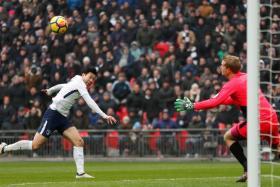 Tottenham's Son Heung Min scoring their second goal against Huddersfield.