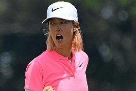 Wie ends title drought in Singapore