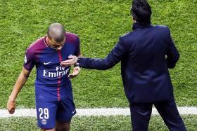 Paris Saint-Germain coach Unai Emery (right) giving striker Kylian Mbappe a pat.