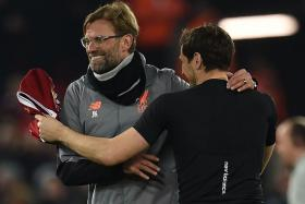 Liverpool manager Juergen Klopp giving Porto goalkeeper Iker Casillas a hug after the game.