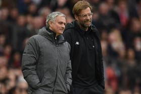 Manchester United manager Jose Mourinho having a word with Liverpool manager Juergen Klopp during the game.