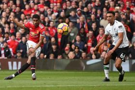 Manchester United's Marcus Rashford (left) firing in the opener after controlling a flick-on by Romelu Lukaku and cutting in past Trent Alexander-Arnold (right).
