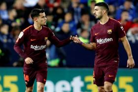 Barcelona midfielder Philippe Coutinho (left) is congratulated by Luis Suarez after scoring their second goal.