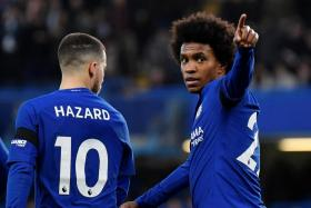 Willian celebrating with Eden Hazard after scoring against Crystal Palace.