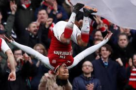 Pierre Emerick-Aubameyang executing an overhead somersault after scoring against Watford.