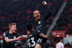 Man City's David Silva gets a lift after scoring their second goal against Stoke City.