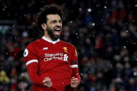 Mohamed Salah scored four in Liverpool's rout of Watford.