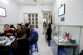 Obama 'bun cha' table encased in Vietnam